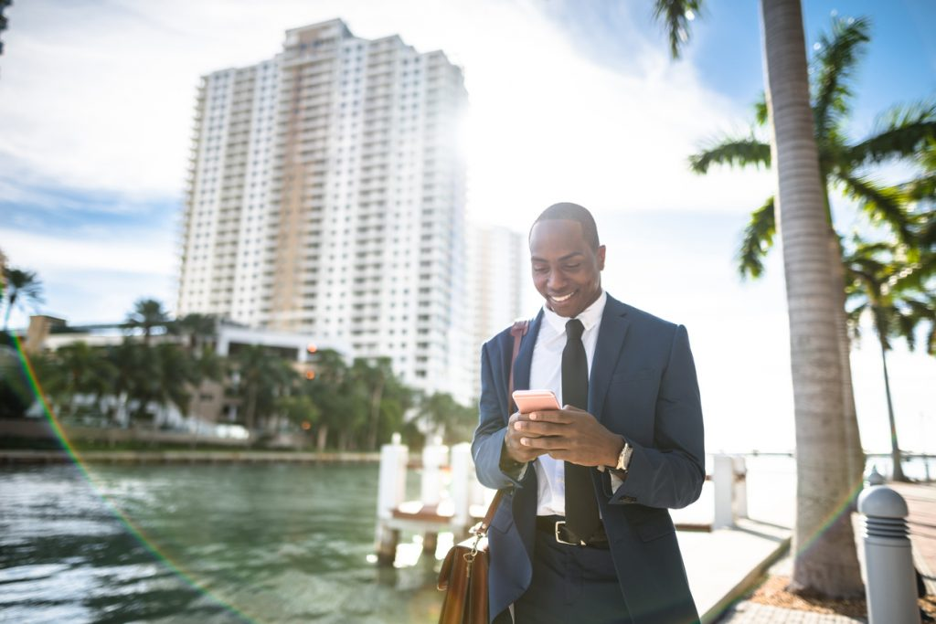 young executive talking on a cellphone in Miami